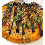broiled mackerel with quinoa on a platter
