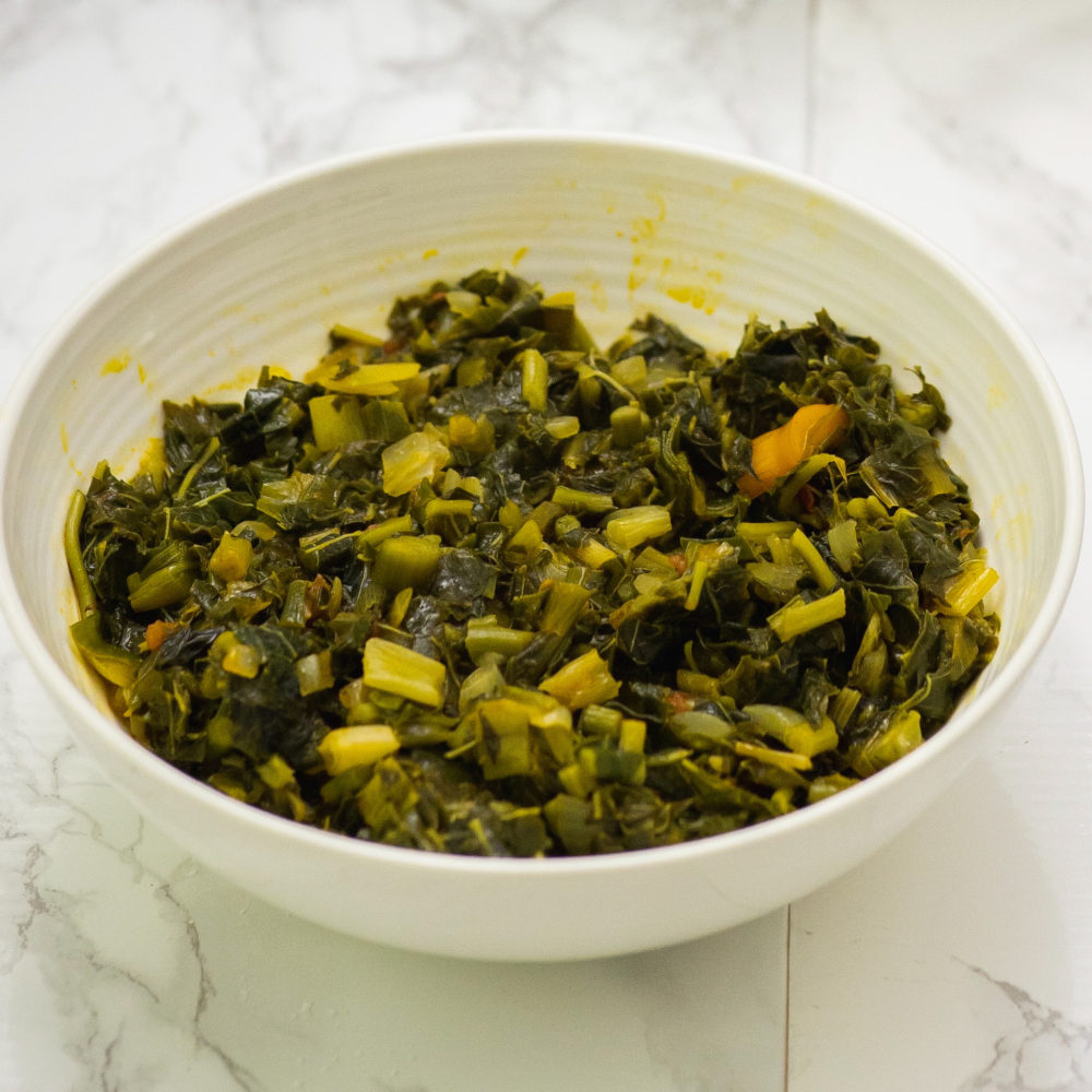 amaranth leaves stew in white bowl